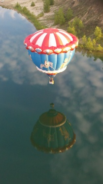 Frank Campanale masterfully guides his hot air balloon just over a lake in Oakland County