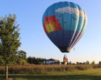 Hot Air Balloon skims the cornfield in Michigan