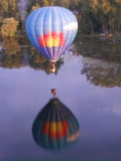 Hot Air Balloon Drifts just above the water on bird watching flight in Michigan